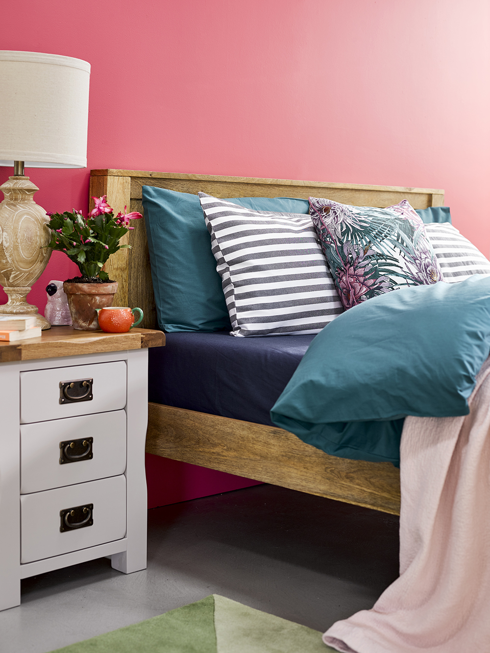 bright pink havana style bedroom with grey furniture