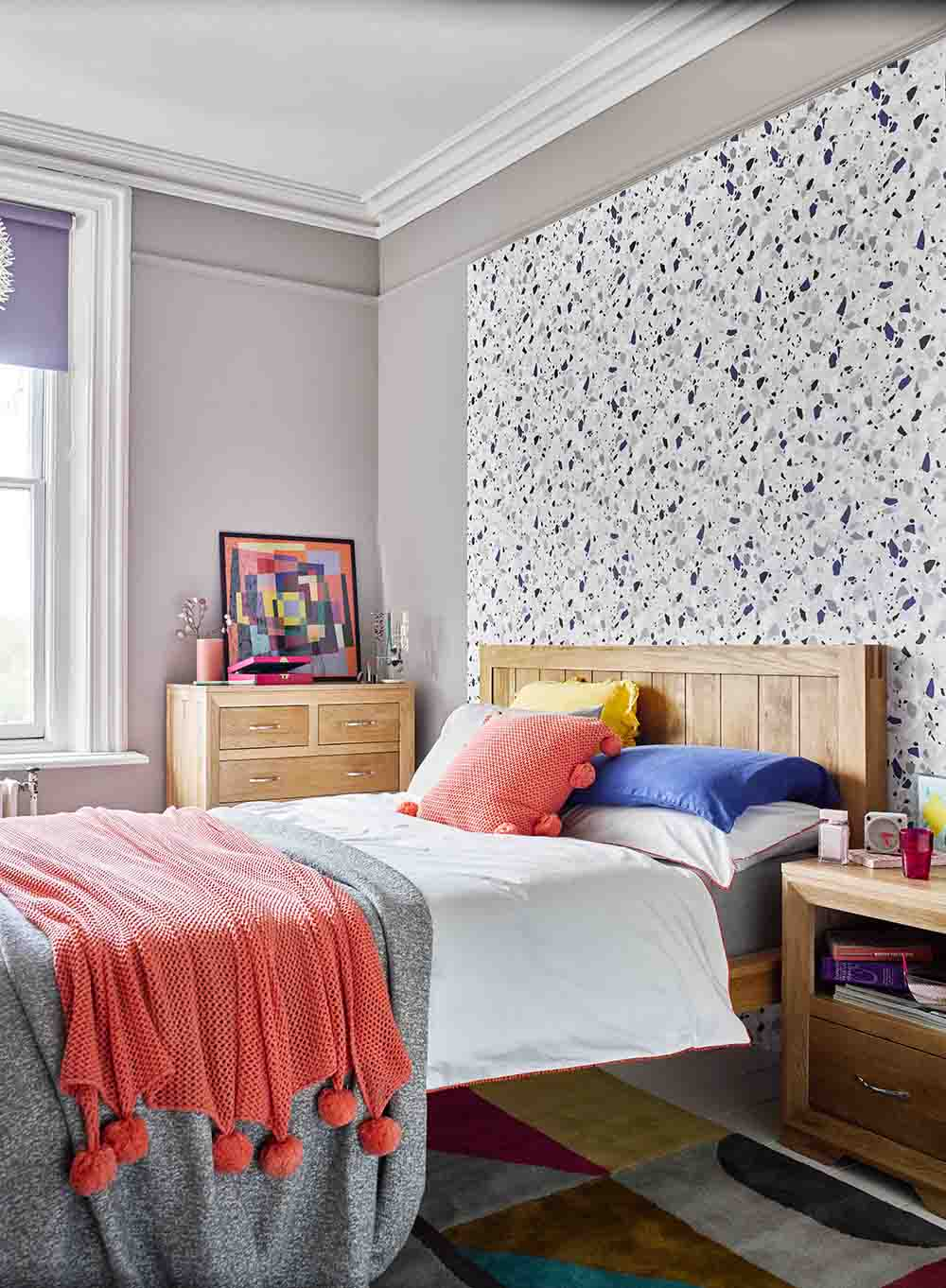 colourful bedroom with terrazzo print wallpaper