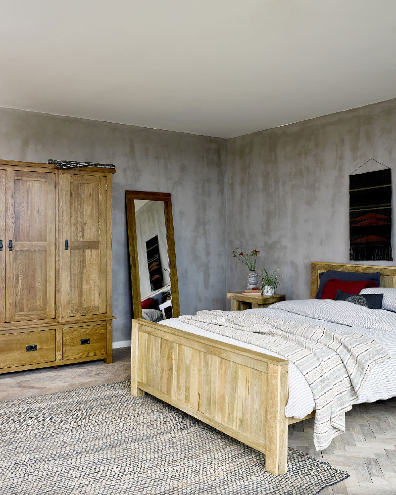 earth toned rustic bedroom with oak furniture
