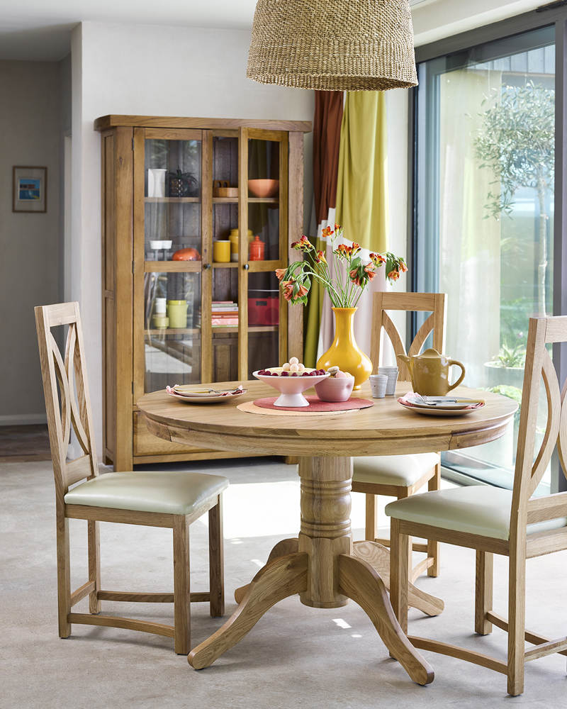 rustic earth toned dining room with round dining table
