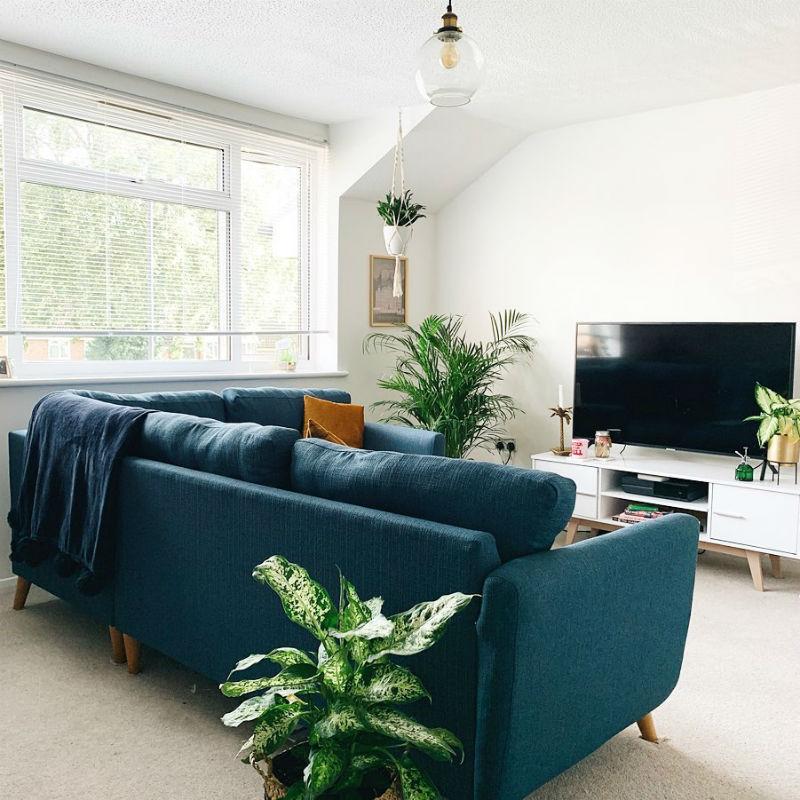 blue corner sofa in white boho living room
