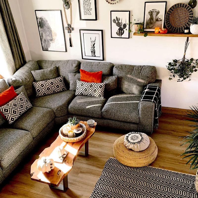 grey modular sofa with geometric red accessories