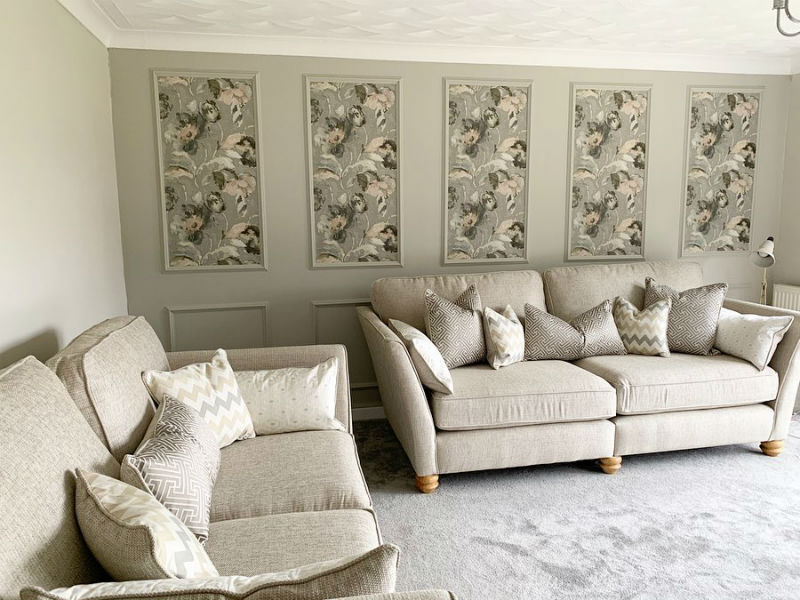 neutral toned living room with decorative panels