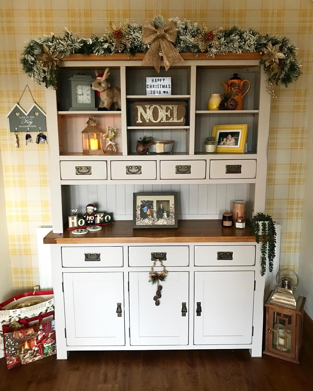 grey painted kitchen dresser with cosy christmas decorations