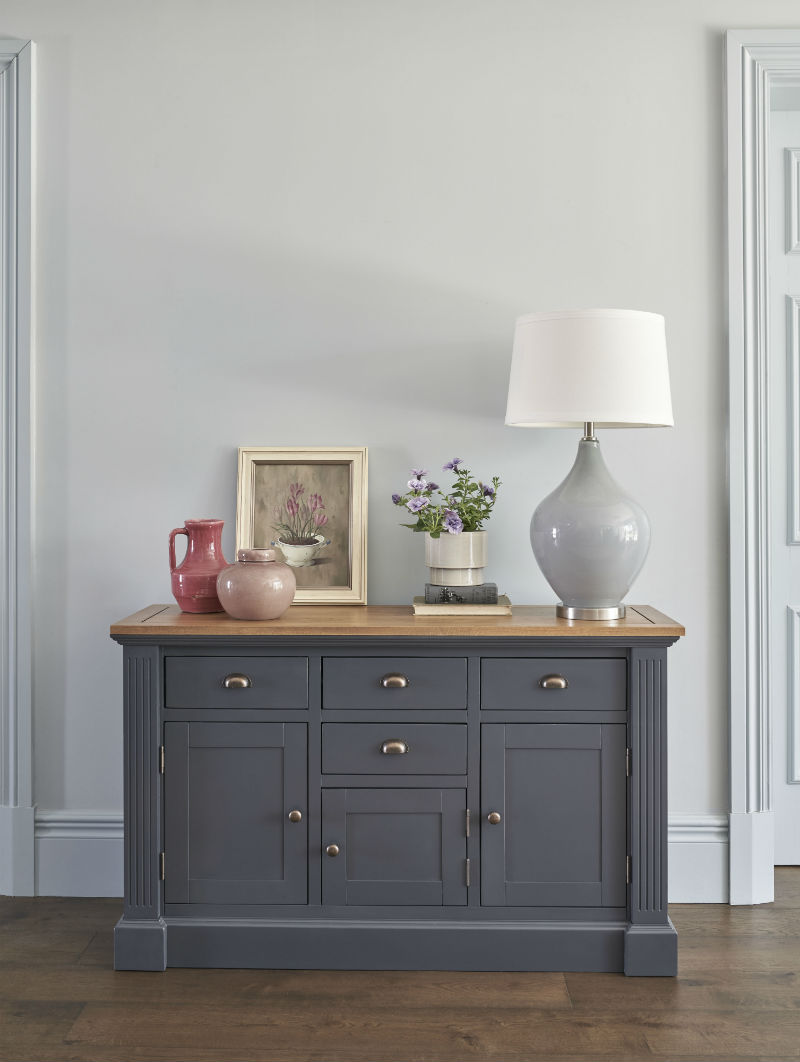 Navy blue painted sideboard with a rustic oak top and an