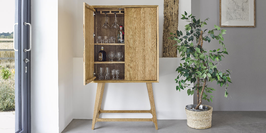 scandinavian style drinks cabinet and house plant