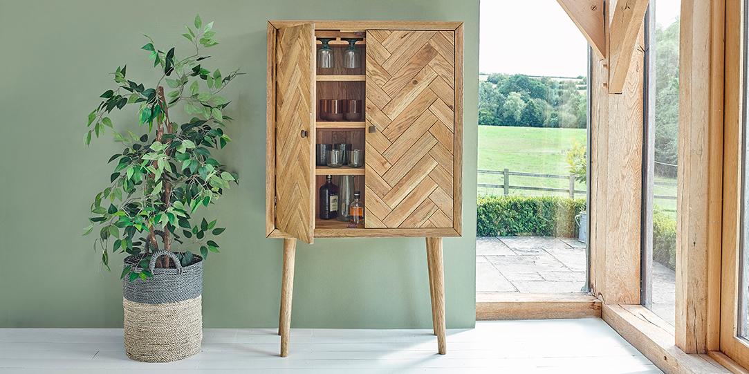 parquet drinks cabinet in green open window dining room