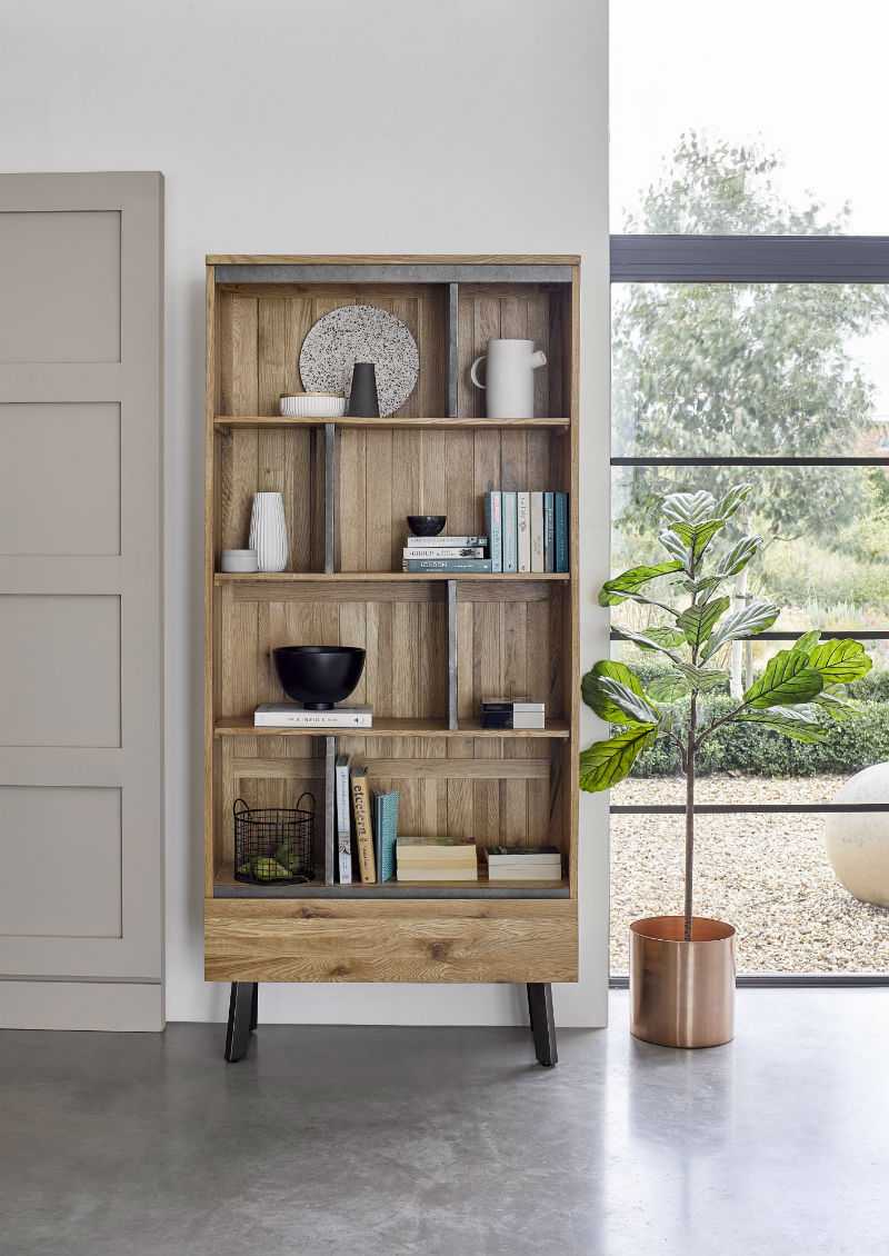 Industrial-style bookcase with quirky metal shelves and sturdy oak paneling