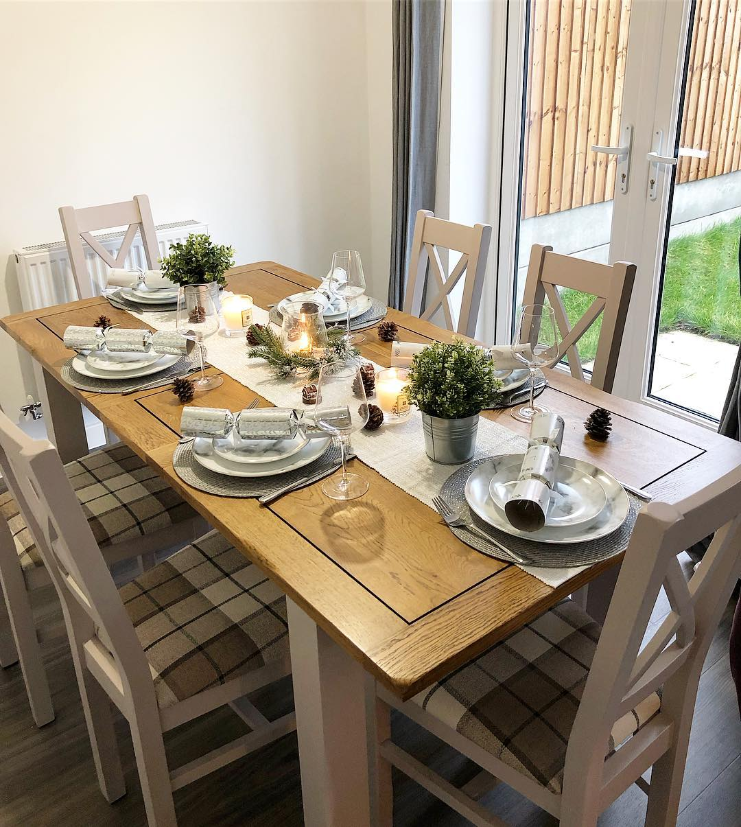 dining table set for christmas with minimal nordic decorations
