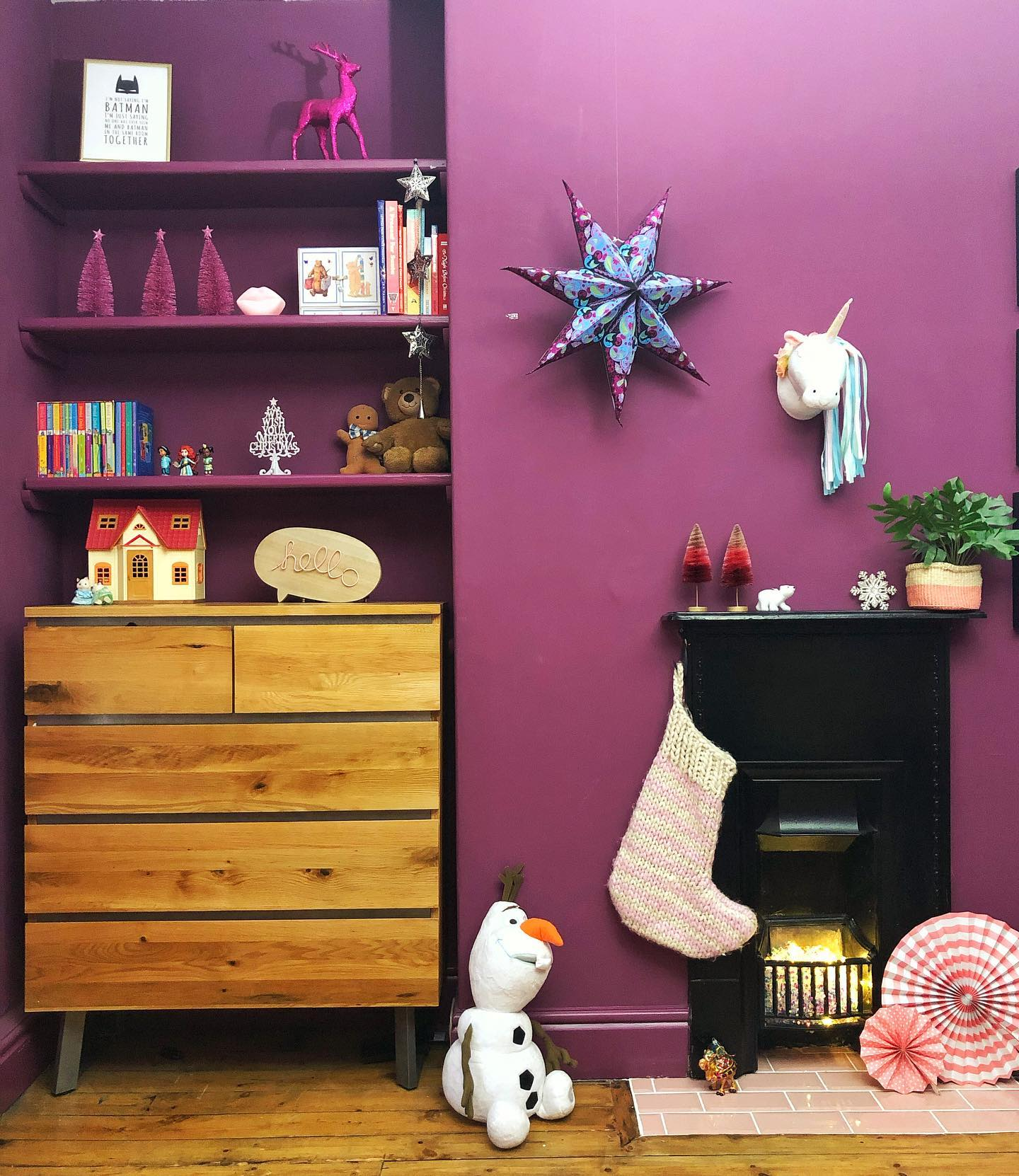 purple themed living room with colourful christmas decorations