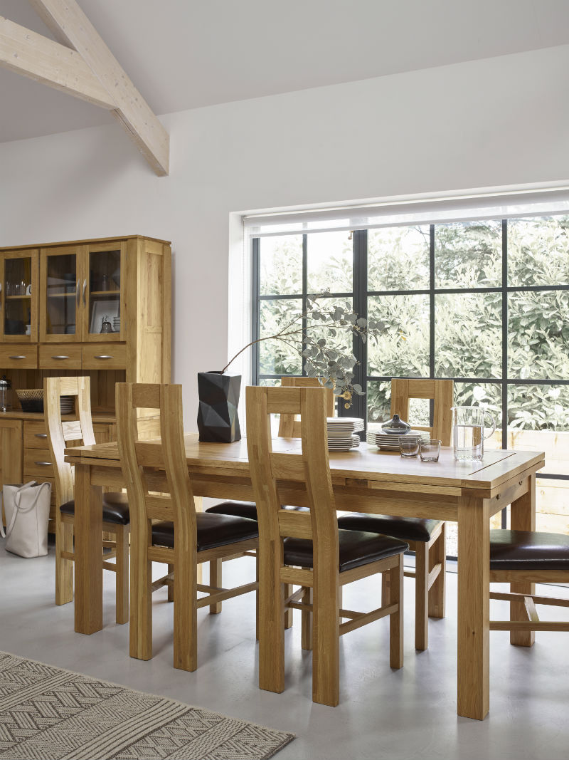 Solid natural oak dining set with curved backed chairs and leather seats