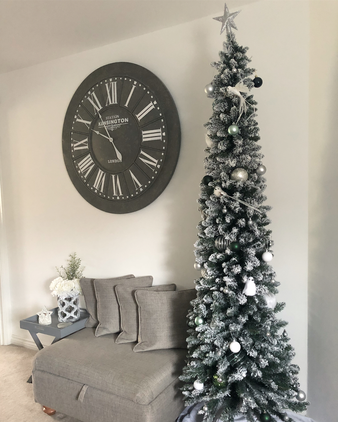 grey themed living room with tall thin christmas tree