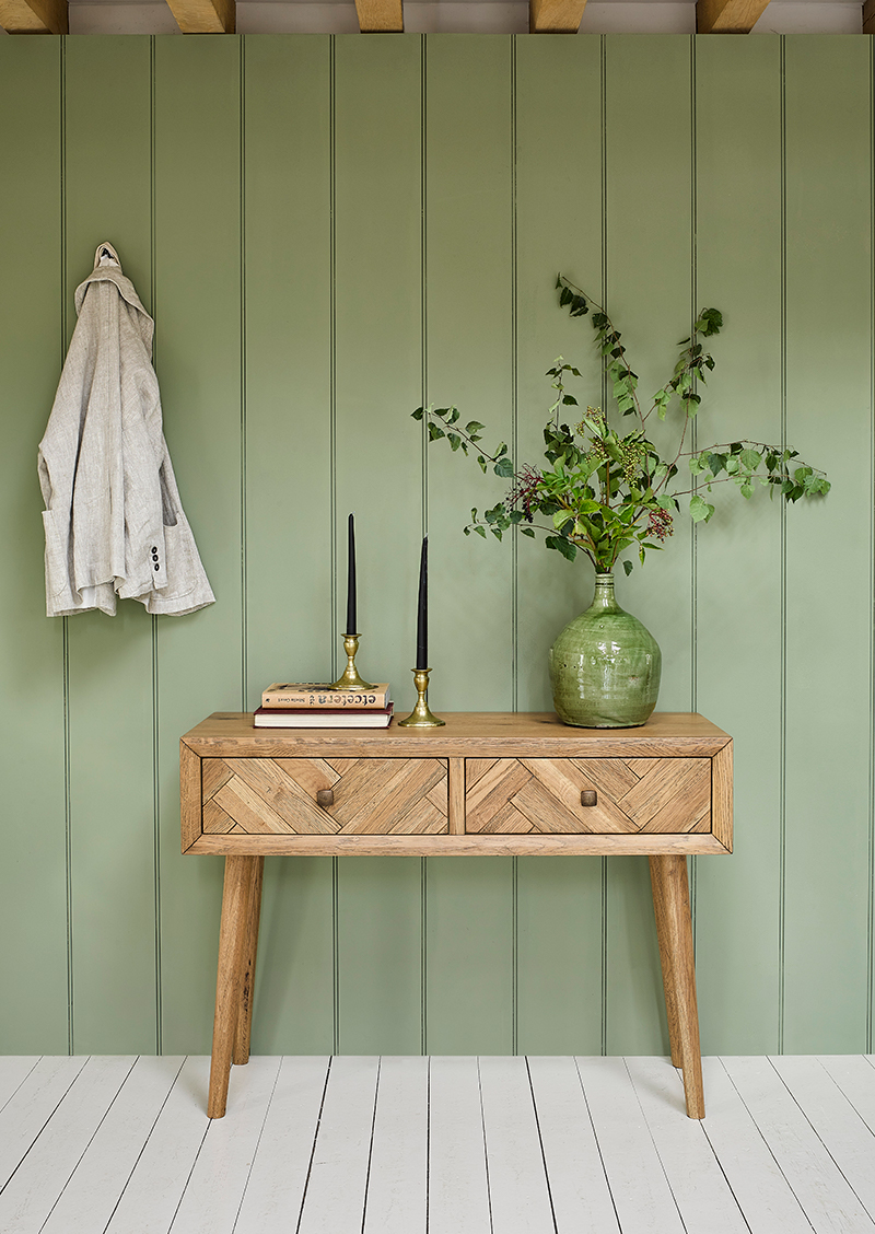 retro style console table with green plants