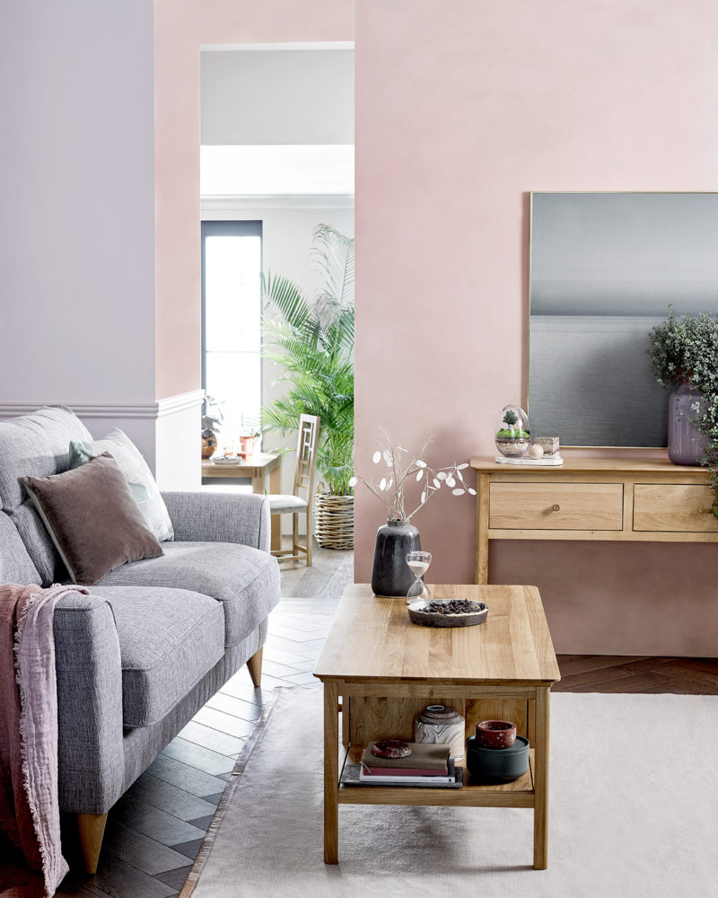 pink and lilac painted living room with scandi style furniture