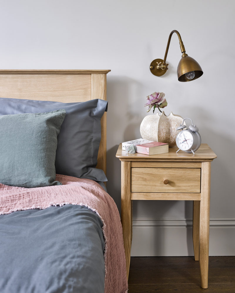 Scandinavian style bedroom with minimalist bedside table