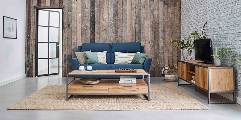 industrial style living room with blue sofa