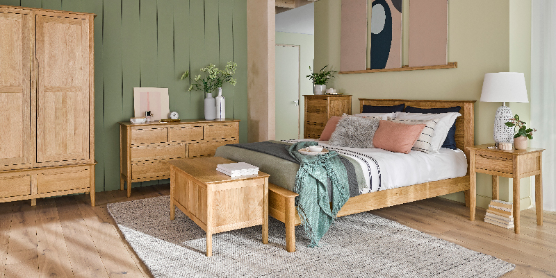 scandi style bedroom with green and pink interiors