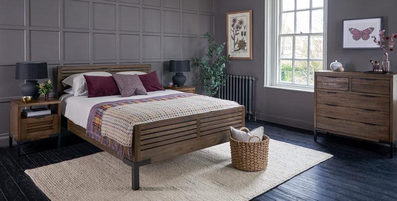 industrial style bedroom with dark acacia wood furniture