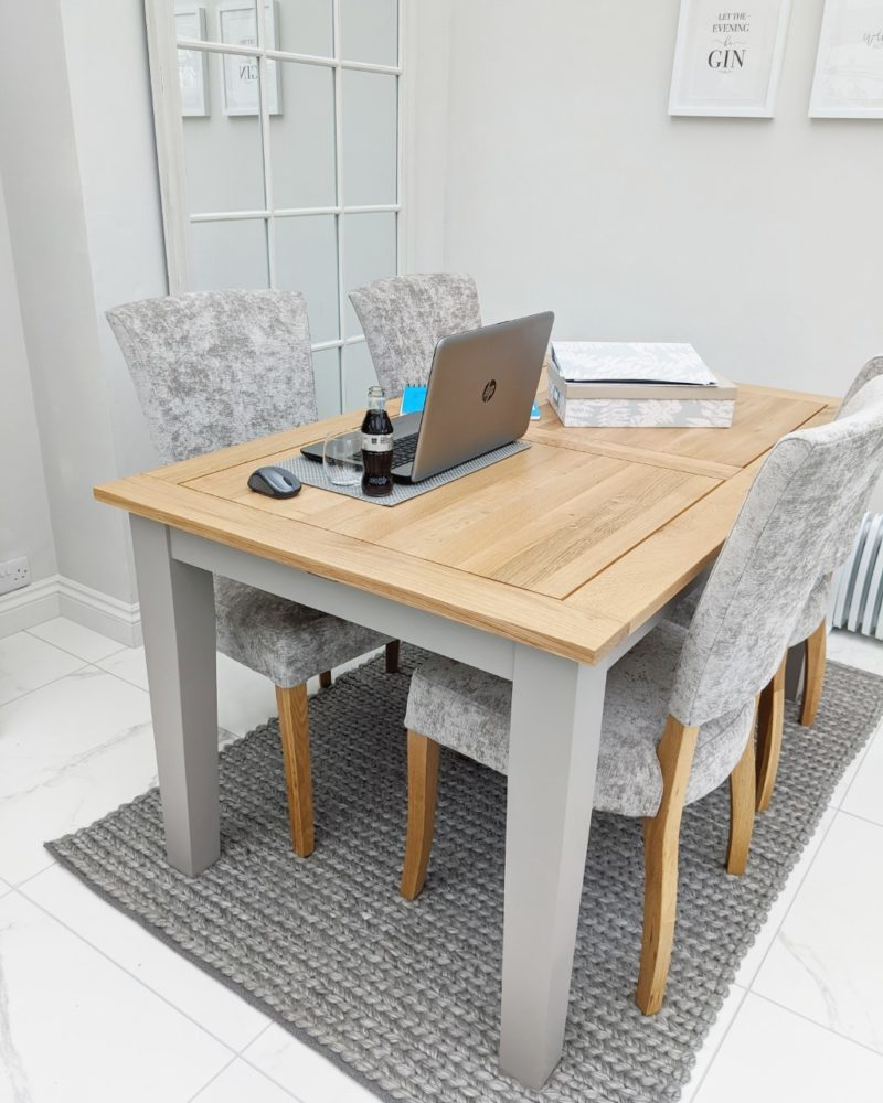 Working from home on grey dining table