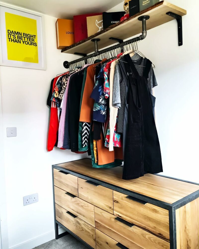 Industrial chest of drawers below hanging clothes rail
