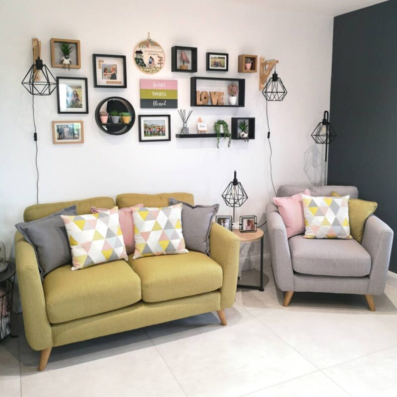 Yellow sofa and grey armchair with colourful cushions