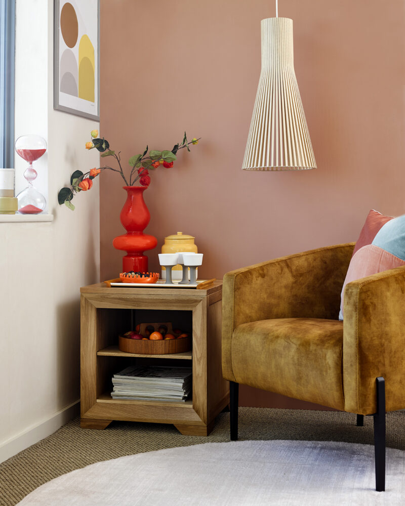Peach tones living room with hanging ceiling light