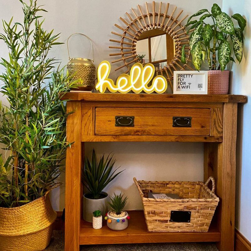 Oak console table with lots of plants