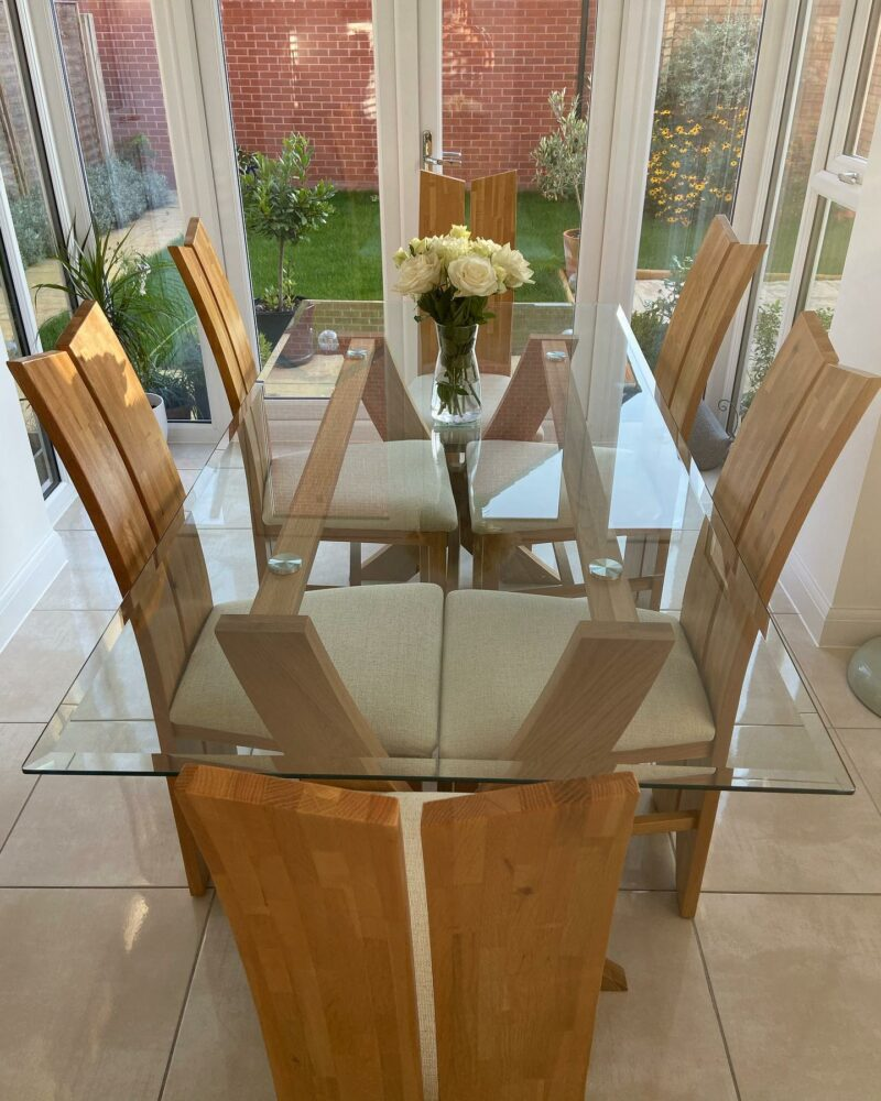 Glass dining table in a conservatory