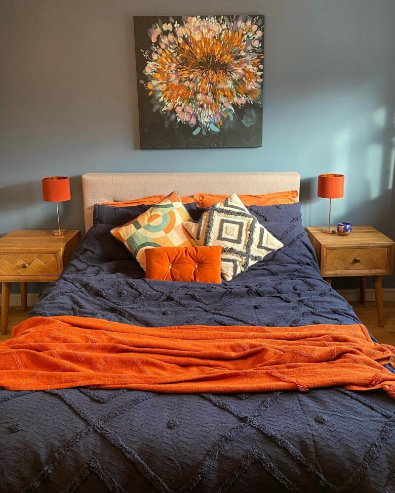 colourful modern bedroom with floral artwork