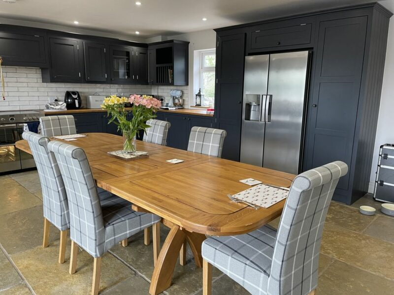 Dining table with fabric chairs in kitchen