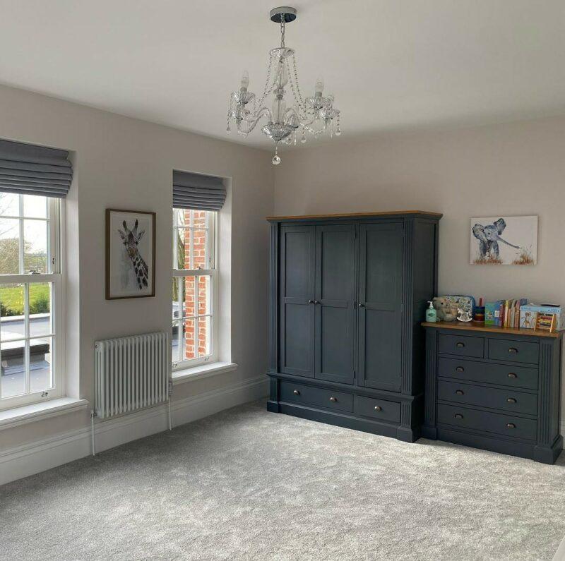 Blue painted triple wardrobe in neutral room