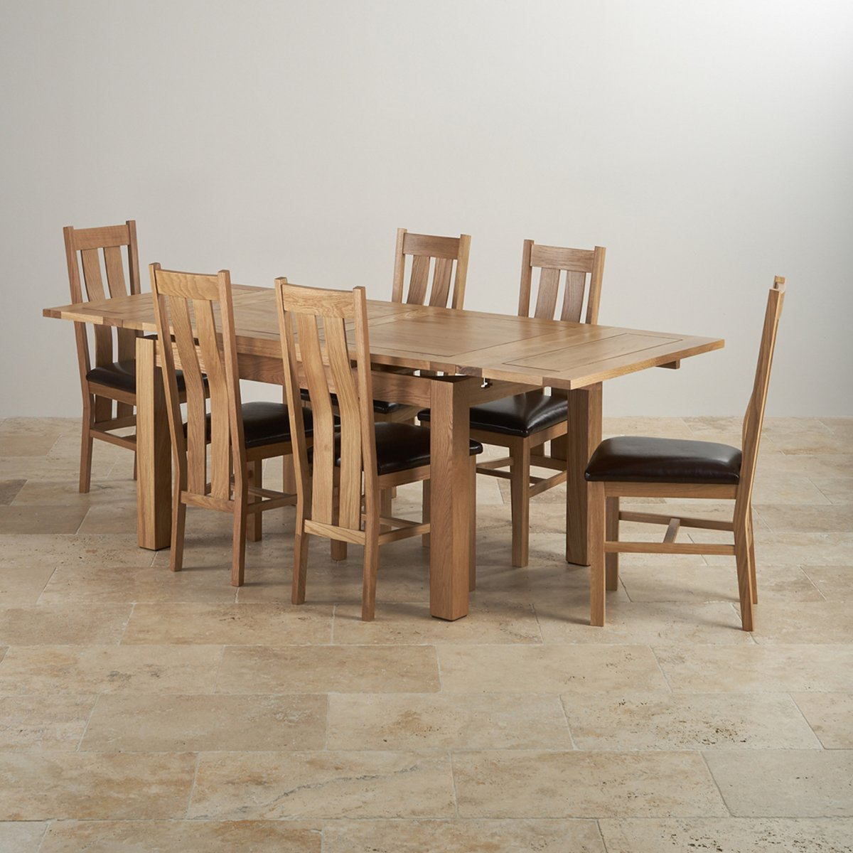 Dorset dining set in oak extending table 6 leather chairs for Oak dining table set