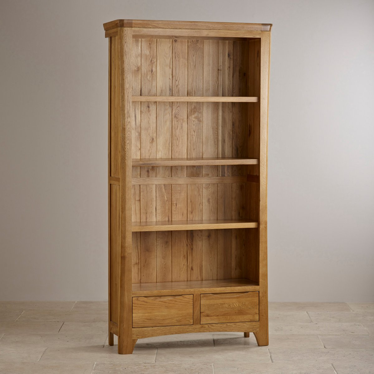 Orrick tall bookcase solid oak oak furniture land for Solid oak furniture