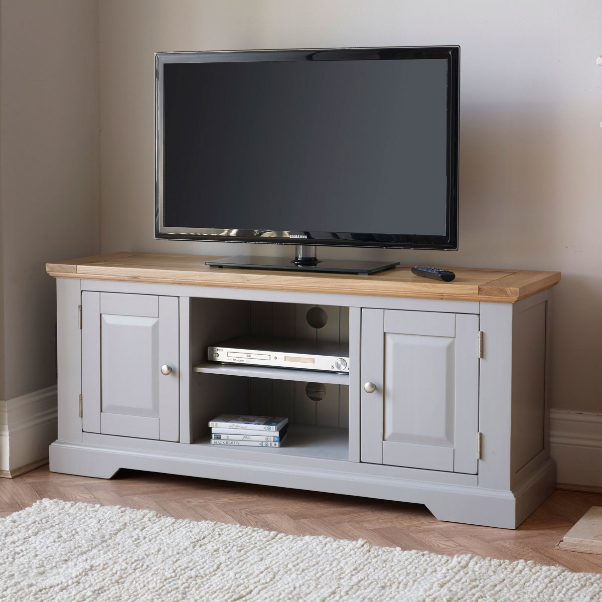 Natural oak and light grey painted TV cabinet.